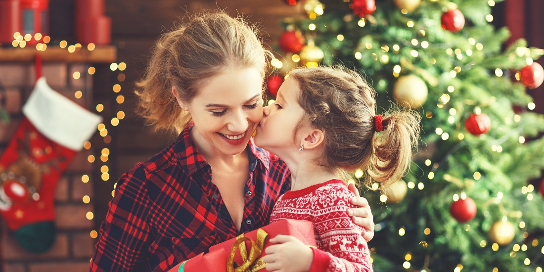 happy family mother and daughter giving christmas gift